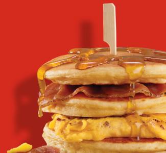 Eggs & Bacon Pancake Stack image